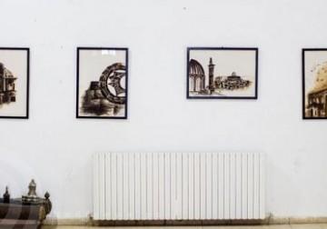 بالصور: فنانة فلسطينية ترسم حكايات شعبها بالقهوة