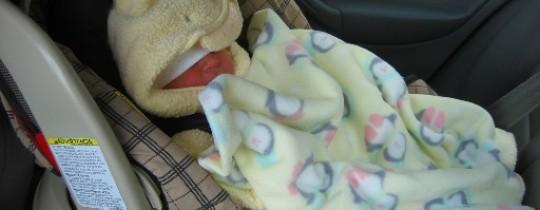 طفل نائم في السيارة - تعبرية