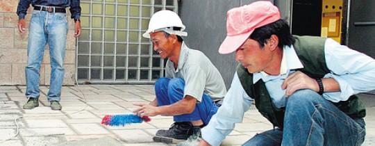 عمال صينيون. صورة توضيحية