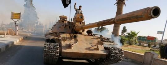 مُدرّعة يعتليها مسلح داعشي