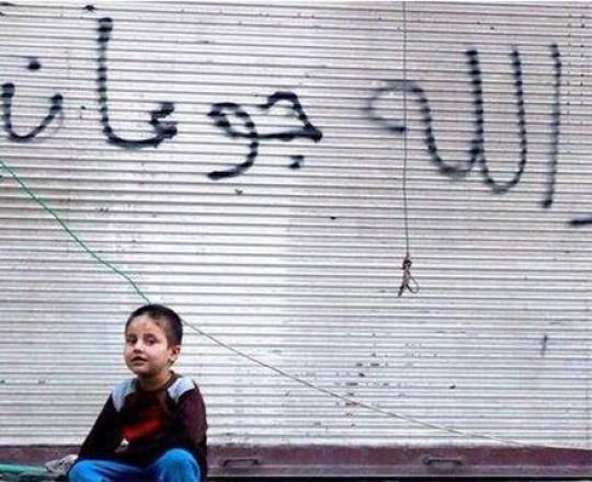 طفل فلسطيني في مخيم البرموك