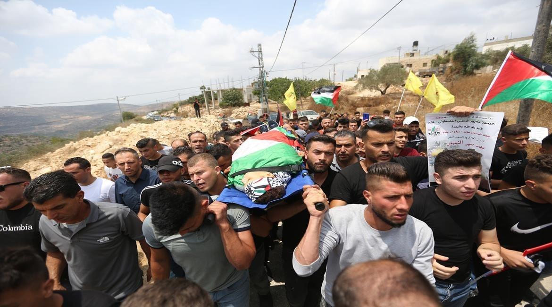 تشييع جثمان الشهيد الطفل محمد منير التميمي في قرية دير نظام برام الله (3).jpg